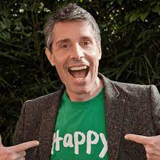 Andy Cope wearing a 'Happy' T-shirt
